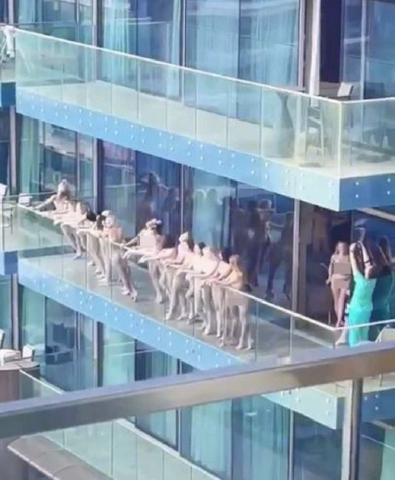 Women arrested after stripping to pose naked for