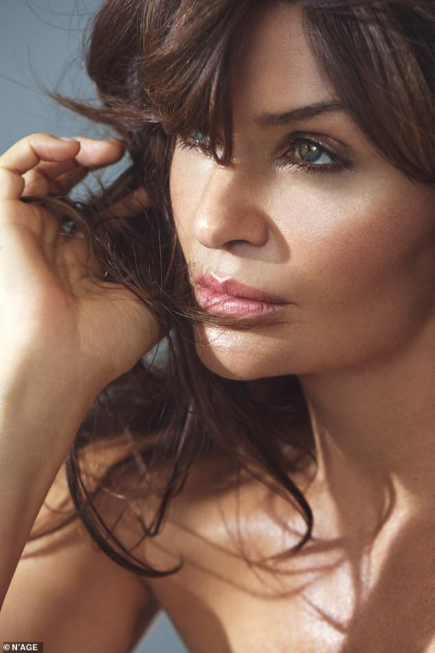 Super model, Helena Christensen, 52, shows off her age-defying physique as she strips?