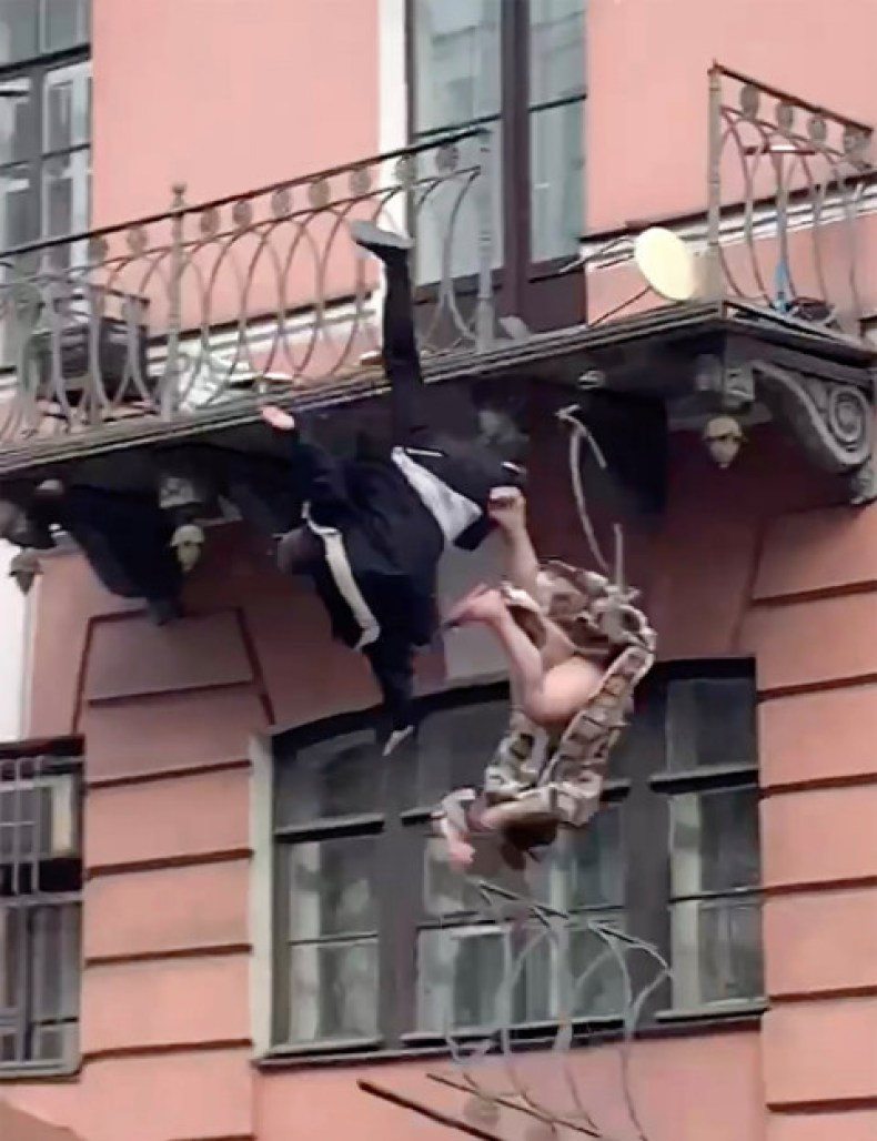 Couple fall off balcony together while arguing