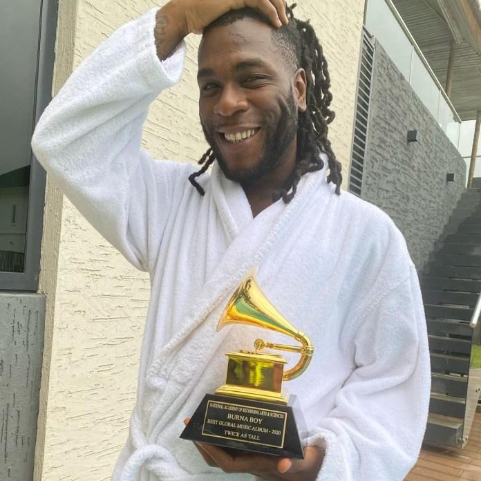 BurnaBoy receives his Grammy awards plaque (photos)
