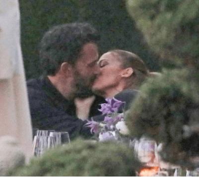 Jennifer Lopez and Ben Affleck seen kissing a dinner party after reuniting