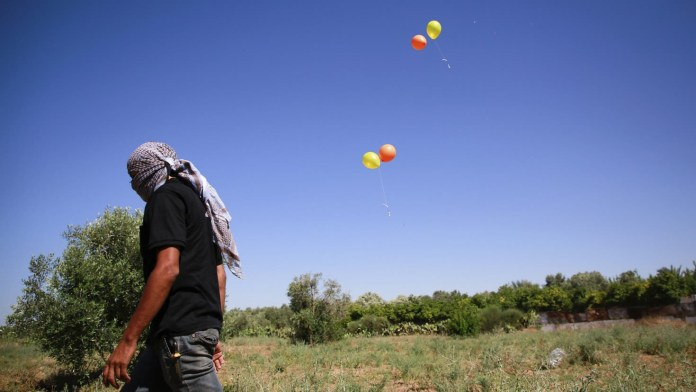 Gaza violence restarts as Israel fires airstrikes at Hamas targets after fire balloons are dropped on Israeli territory