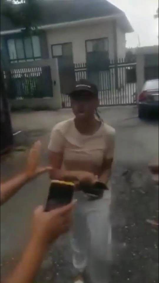 Nigerian driver records moment lady who allegedly refused to pay him for his services after arriving her destination almost assaulted him (video)