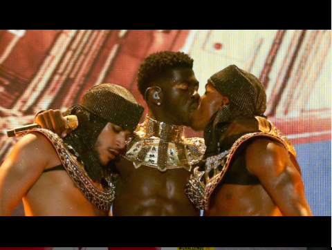 Lil Nas X kisses a male dancer on stage at 2021 BET Awards, before slamming critics on Twitter for claiming he disrespected his 'African ancestors' (photos)