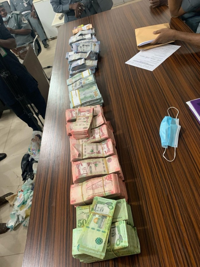 Man arrested with $184,800 concealed in a diaper at Kano airport (photos)