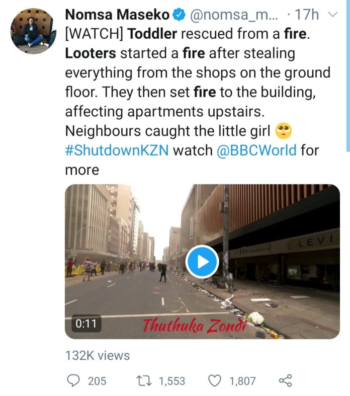 Toddler thrown from burning building in South Africa after looters set it on fire (video)