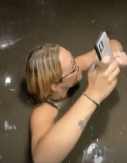 Friends trapped in elevator film terrifying moment flood water gushes in up to their necks