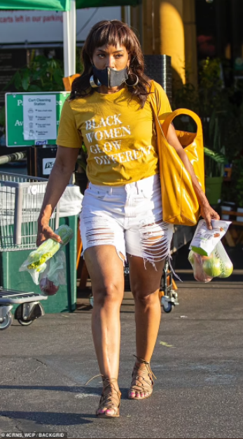 Angela Bassett, 62, looks decades younger as she runs errands in ripped shorts