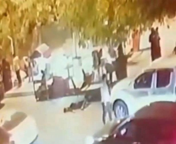 Woman stabbed to death in street for