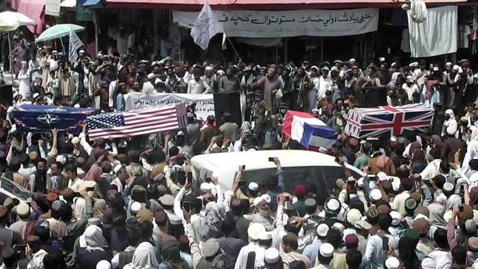 Taliban organize street carnival celebrating US withdrawal from Afghanistan with coffins draped with American flags (photos)