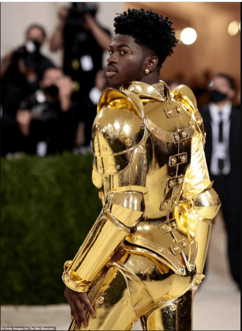 Lil Nas X debuts three outfits on the Met Gala red carpet including a gold suit of armor (photos)