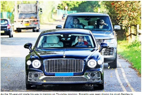 Cristiano Ronaldo closely followed by bodyguards as he drives his Bentley to training (photo) ?
