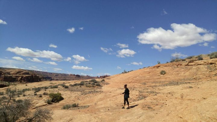 21.6 Alexis Chateau Corona Arches Hiking Trail Utah.jpg