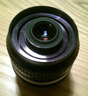 Lens with reversed front element