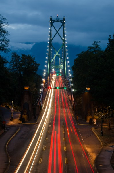 Cars travel across Vancouver's Lions Gate Bridge at night.