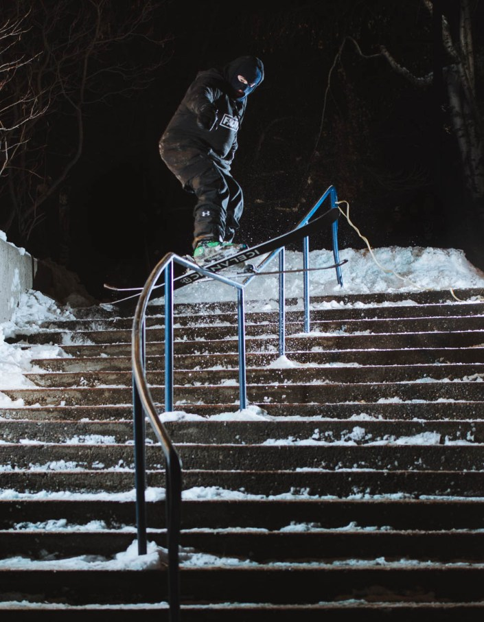 A skier grinds a rail at Thompson Rivers University