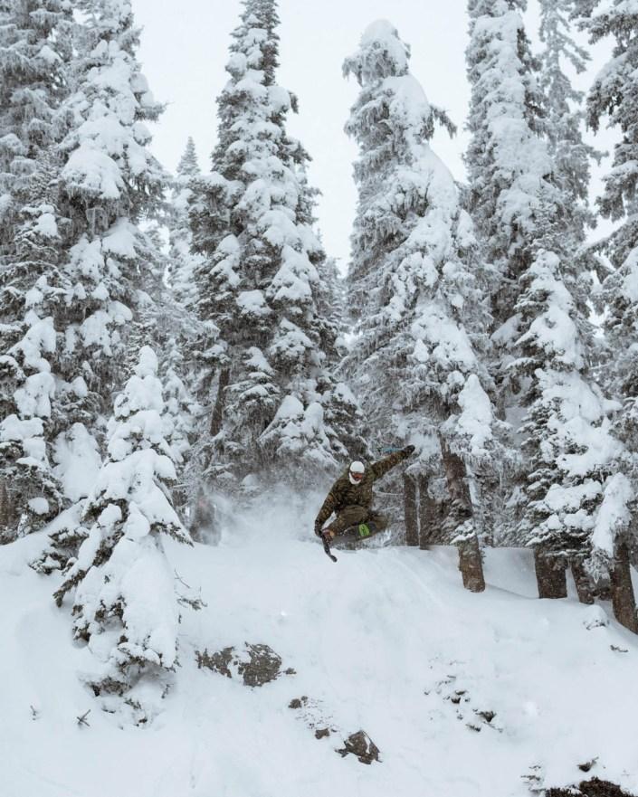 A skier hits a drop at Sun Peaks Resort