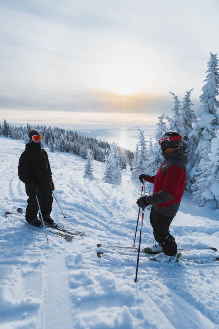 Two skiers at the top of Sun Peaks Resort