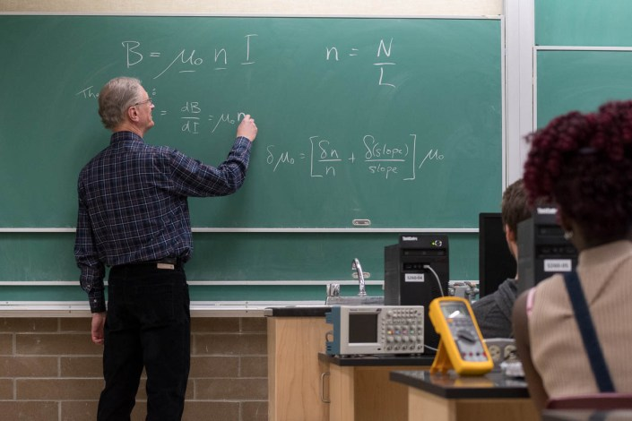 A professor of engineering at Thompson Rivers University gives a lecture on magnetism.