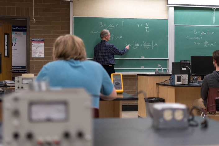 Engineering students at Thompson Rivers University listen to a lecture on magnetism.