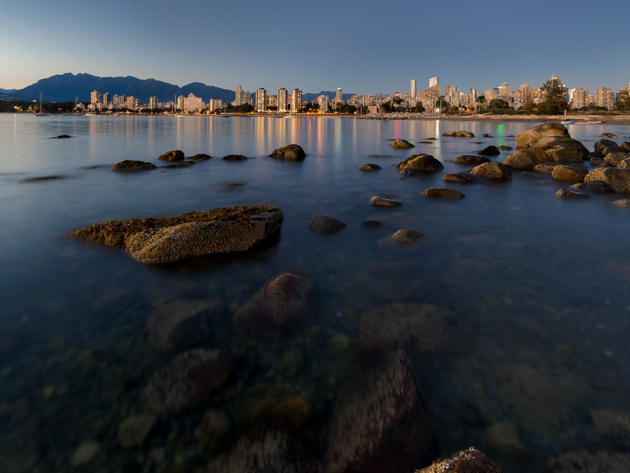 Downtown Vancouver is reflected in the waters of English Bay