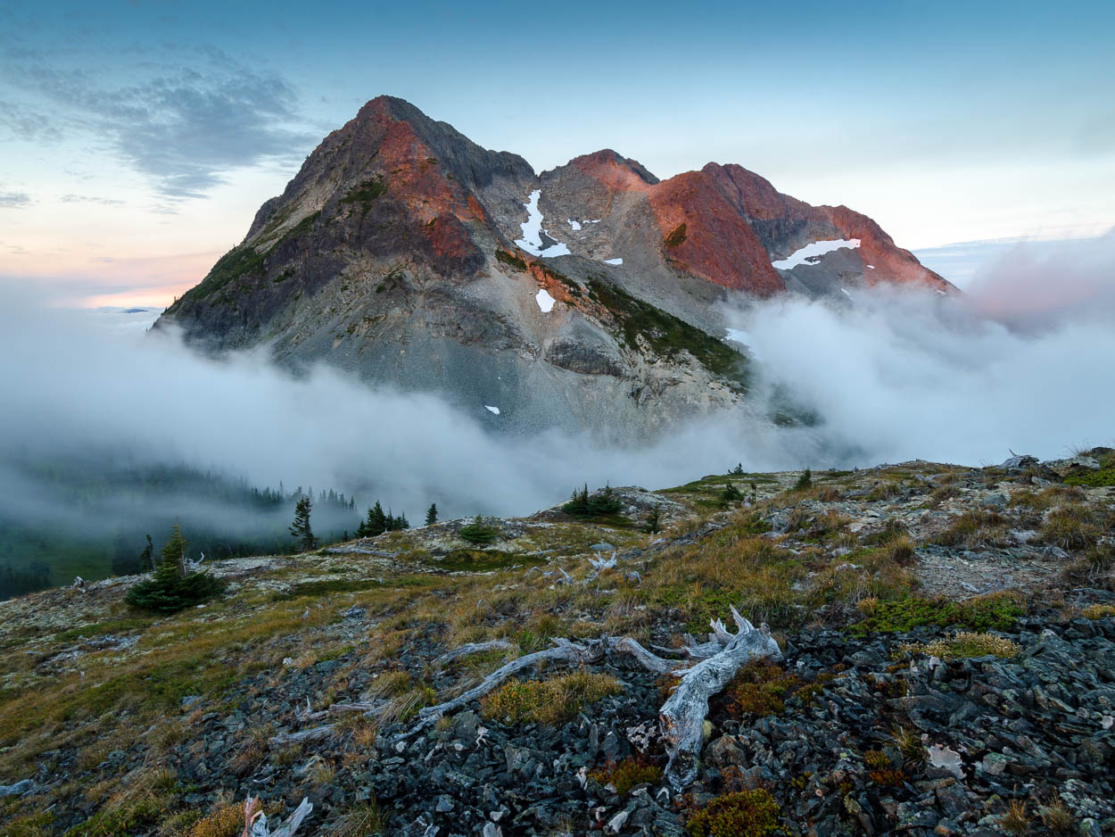First light hits the foggy peak of Coquihalla Mountain.