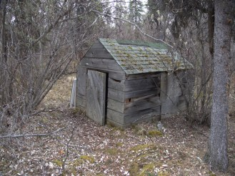 Small shed possibly used to house farm animals.