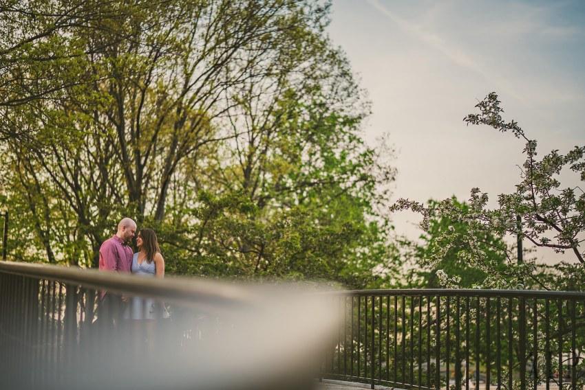 engagement portrait on bridge at esplanade