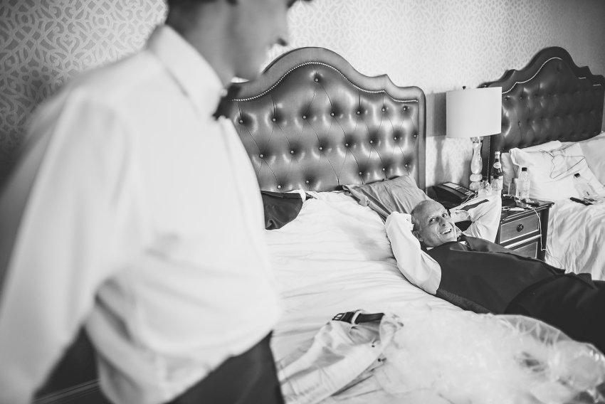 groom father lying on bed