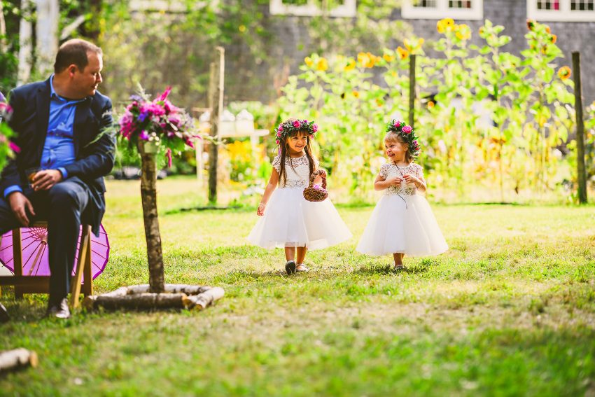 flower girls walking up aisle
