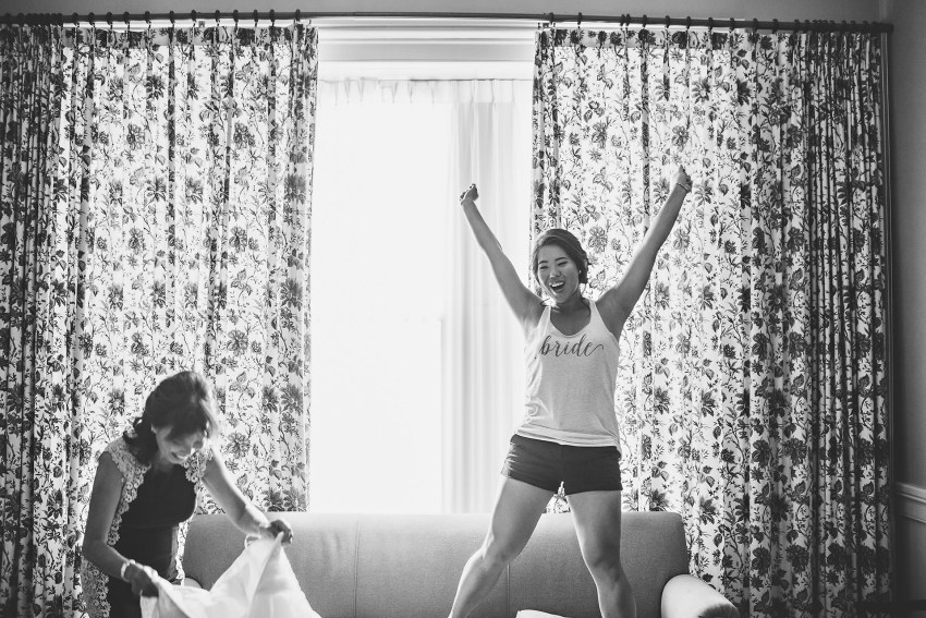 bride dancing on couch before wedding