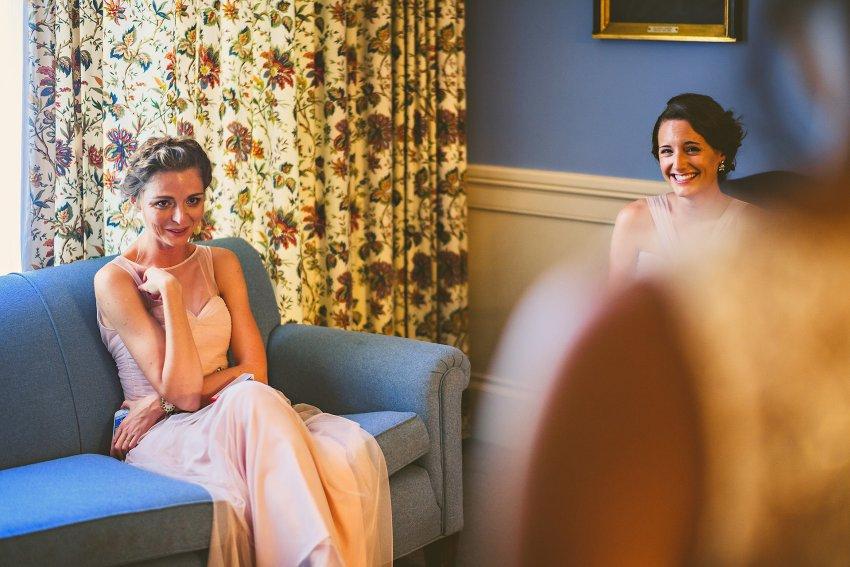 bridesmaids emotional with bride