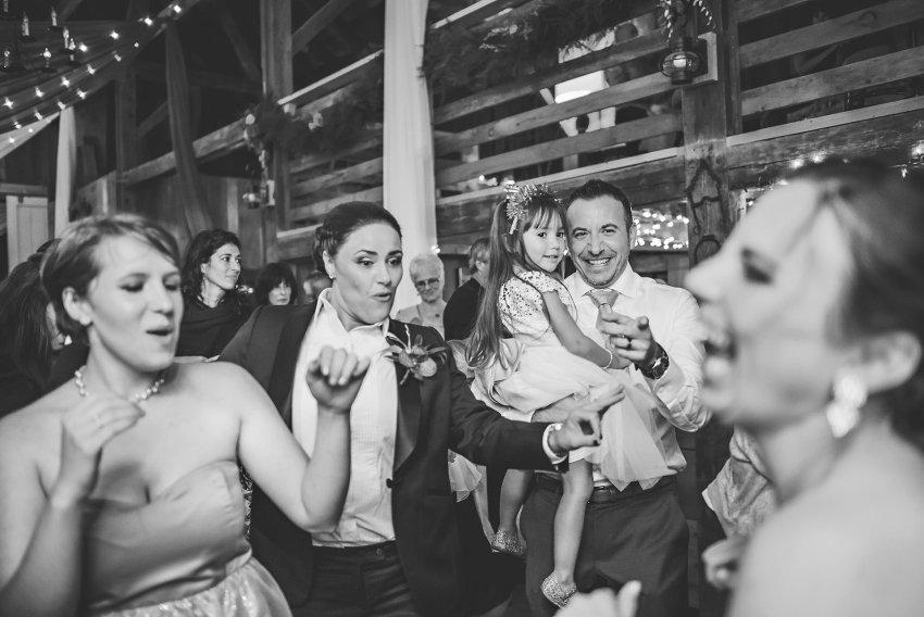 brides dancing with wedding party