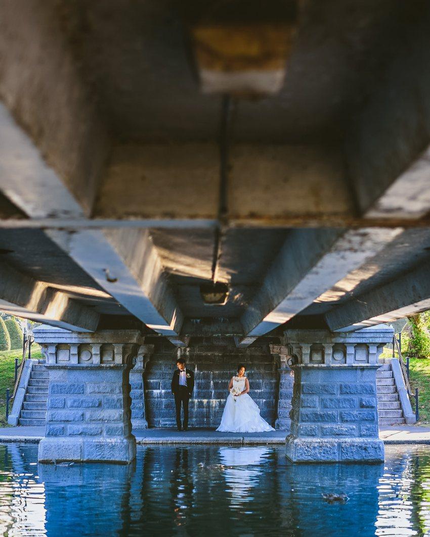 artistic wedding portrait under Public Garden bridge