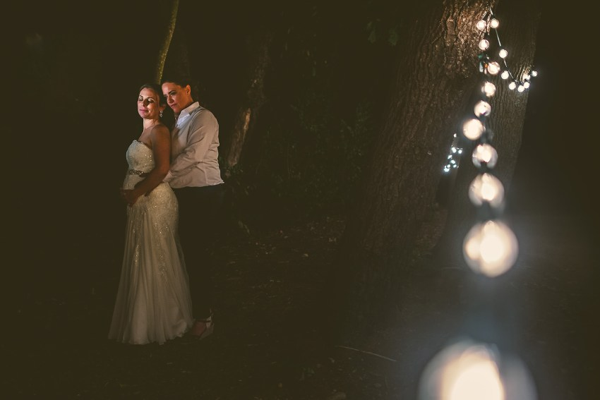 Intimate Josias River Farm Night Wedding Portrait with market lights