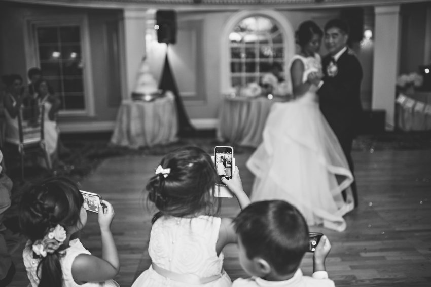 ringbearers and flower girls recording father daughter dance