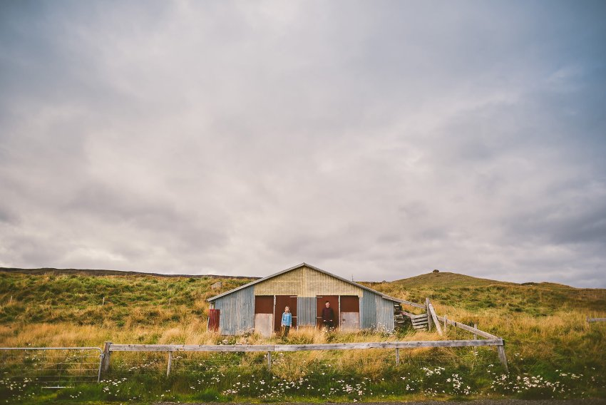 couple in front of shack in Iceland