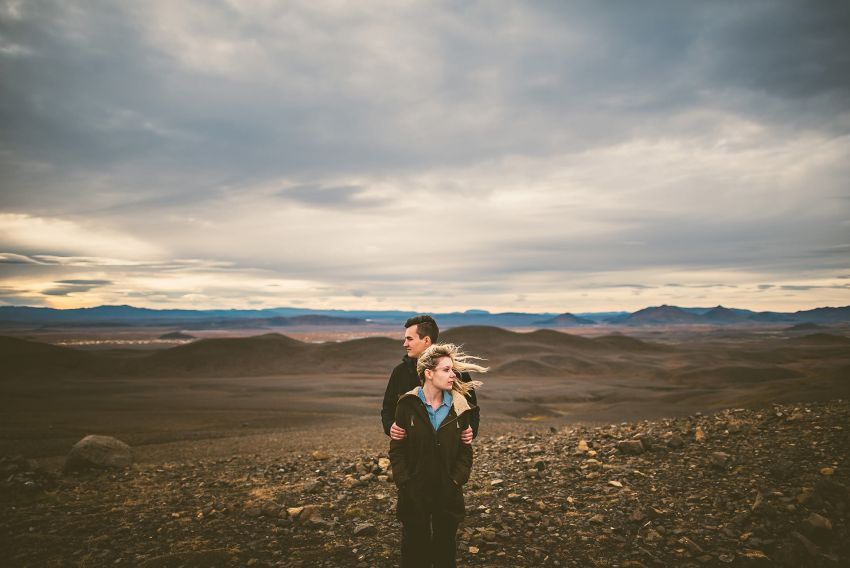 windy engagement photo in Iceland