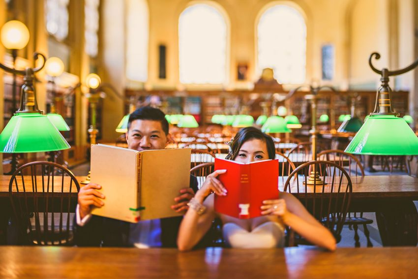 wedding portrait with books at Boston Public Library