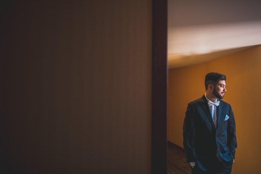 Dramatic hallway groom portrait