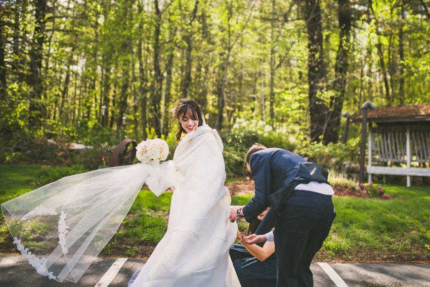 Bride getting bustled