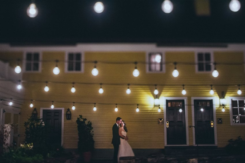 Wedding portrait under string lights