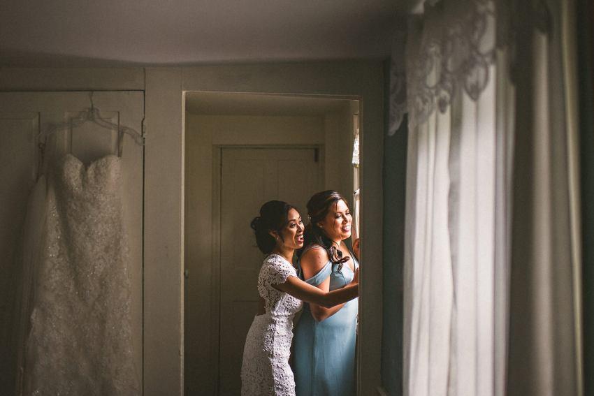 Bride with bridesmaid before wedding