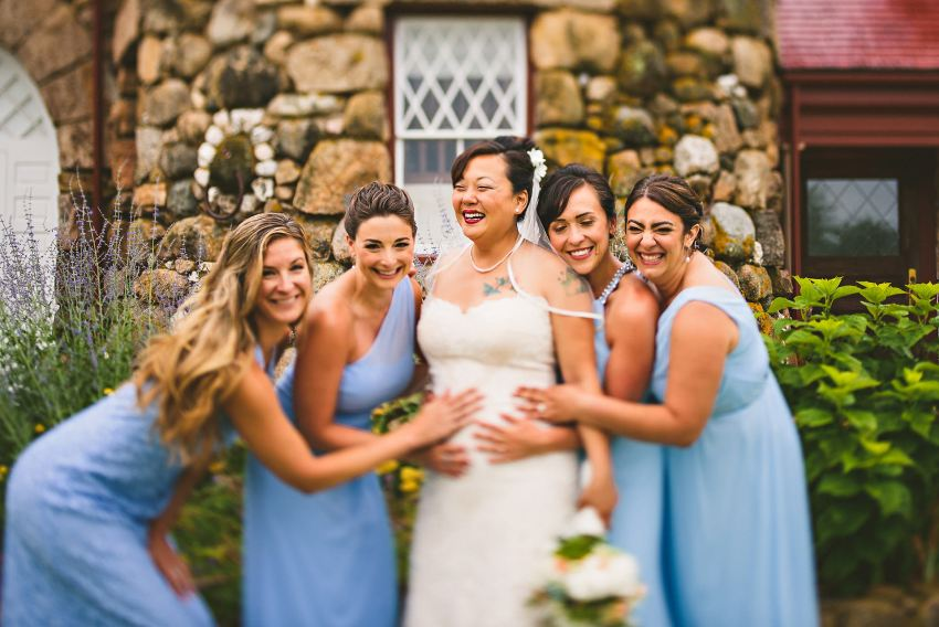 Pregnant bride with bridesmaids
