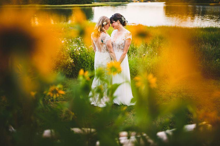 Kittery same sex wedding portrait through flowers