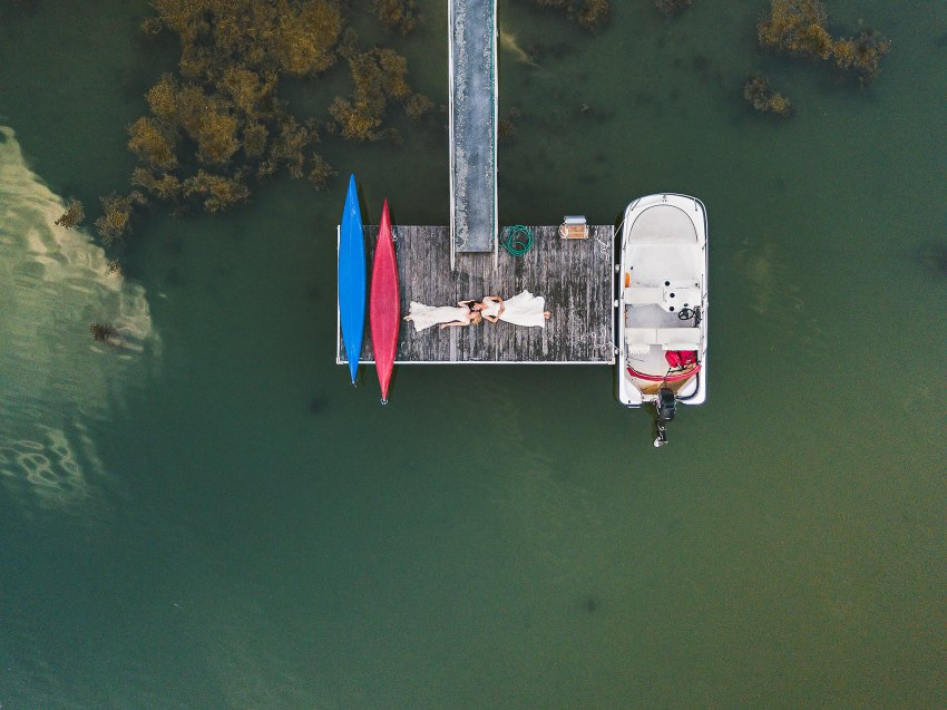 Dramatic Kittery same sex wedding drone portrait on dock