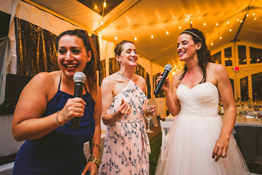 Bride singing with friends at wedding
