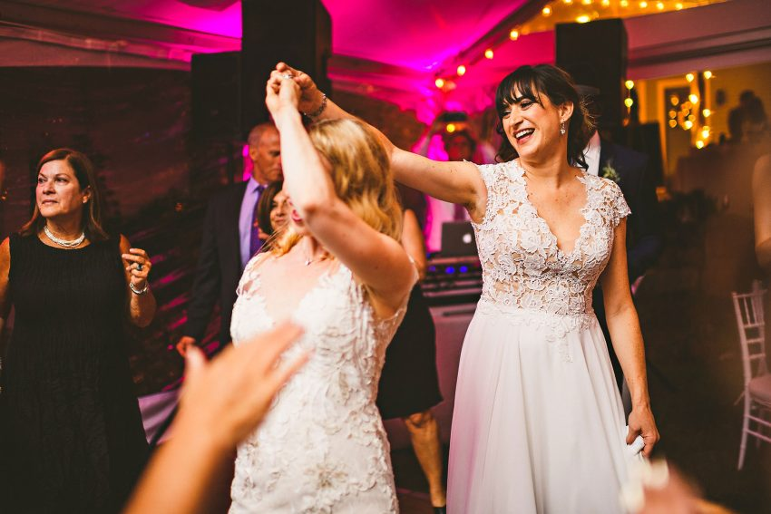 Same sex wedding brides dancing