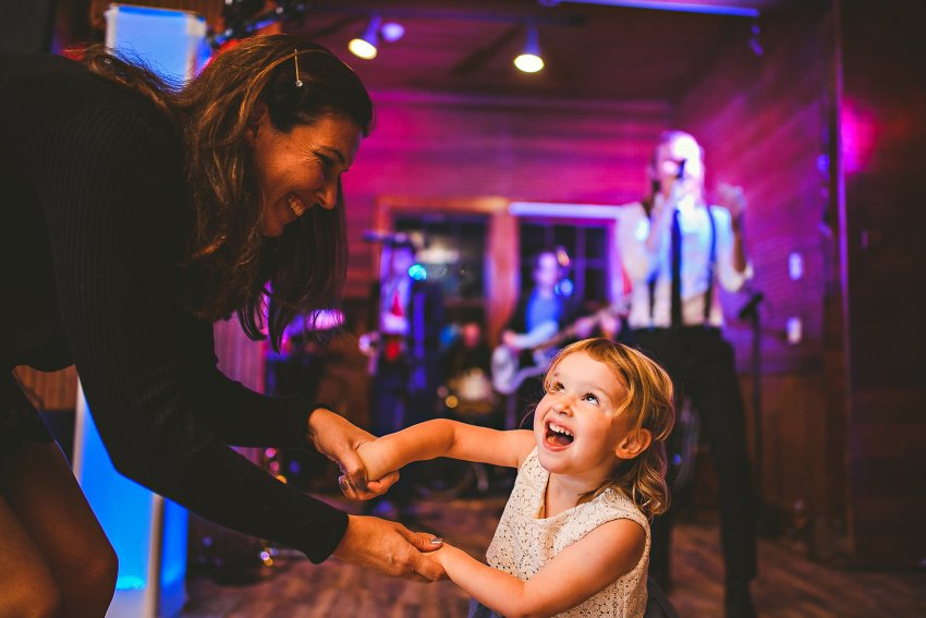 Flower girl dancing with mom