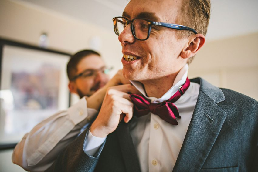 Groomsmen putting on bowtie